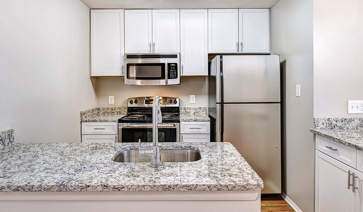 Burke Shire Commons Apartments - White Kitchen with Marbled Granite Countertops - Burke, Virginia